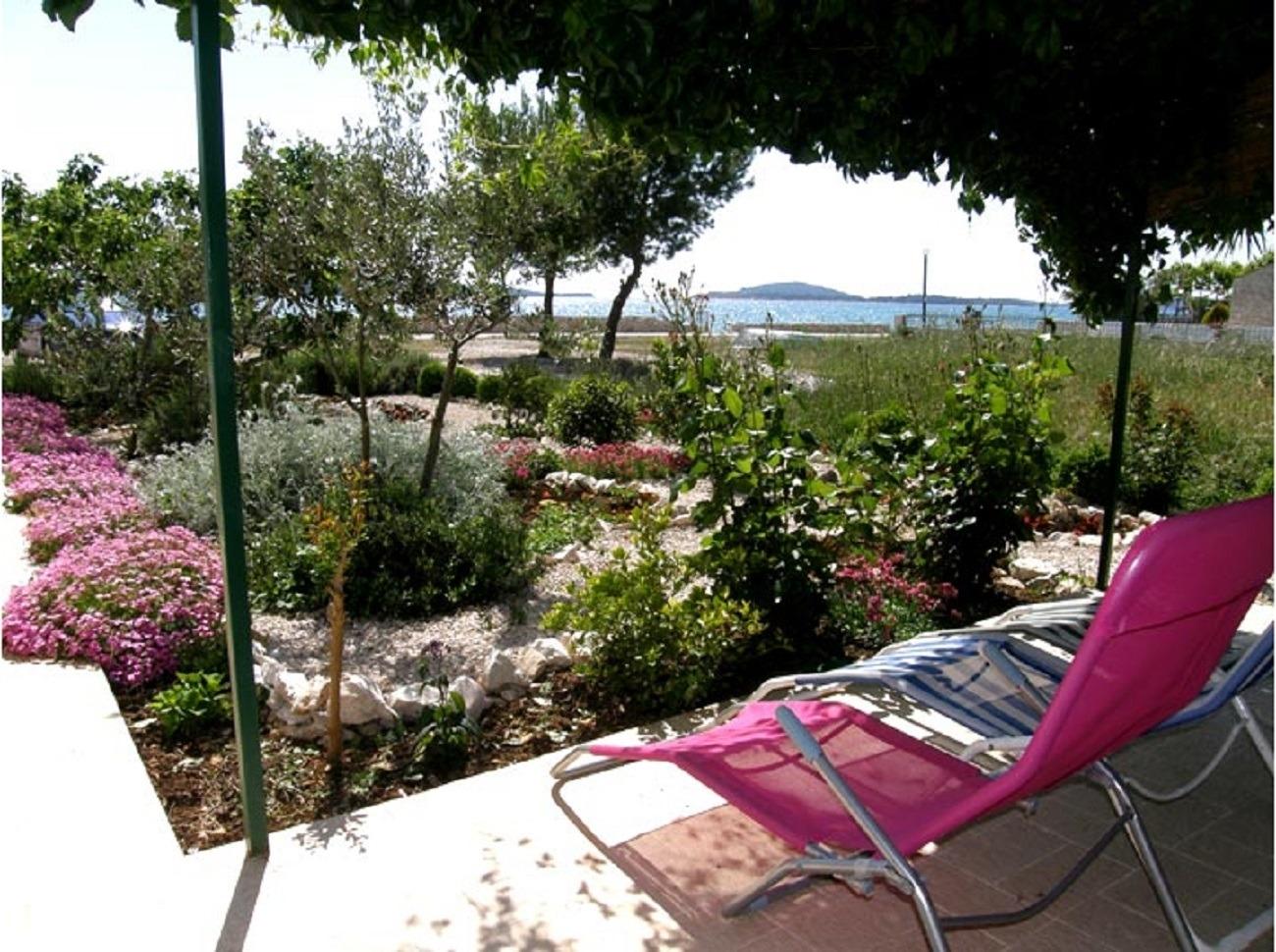 Apartment Apartment Mira - 20 m from pebble beach: A1 Zaboric, Riviera Sibenik 52709, Zaboric, , Region Split-Dalmatia