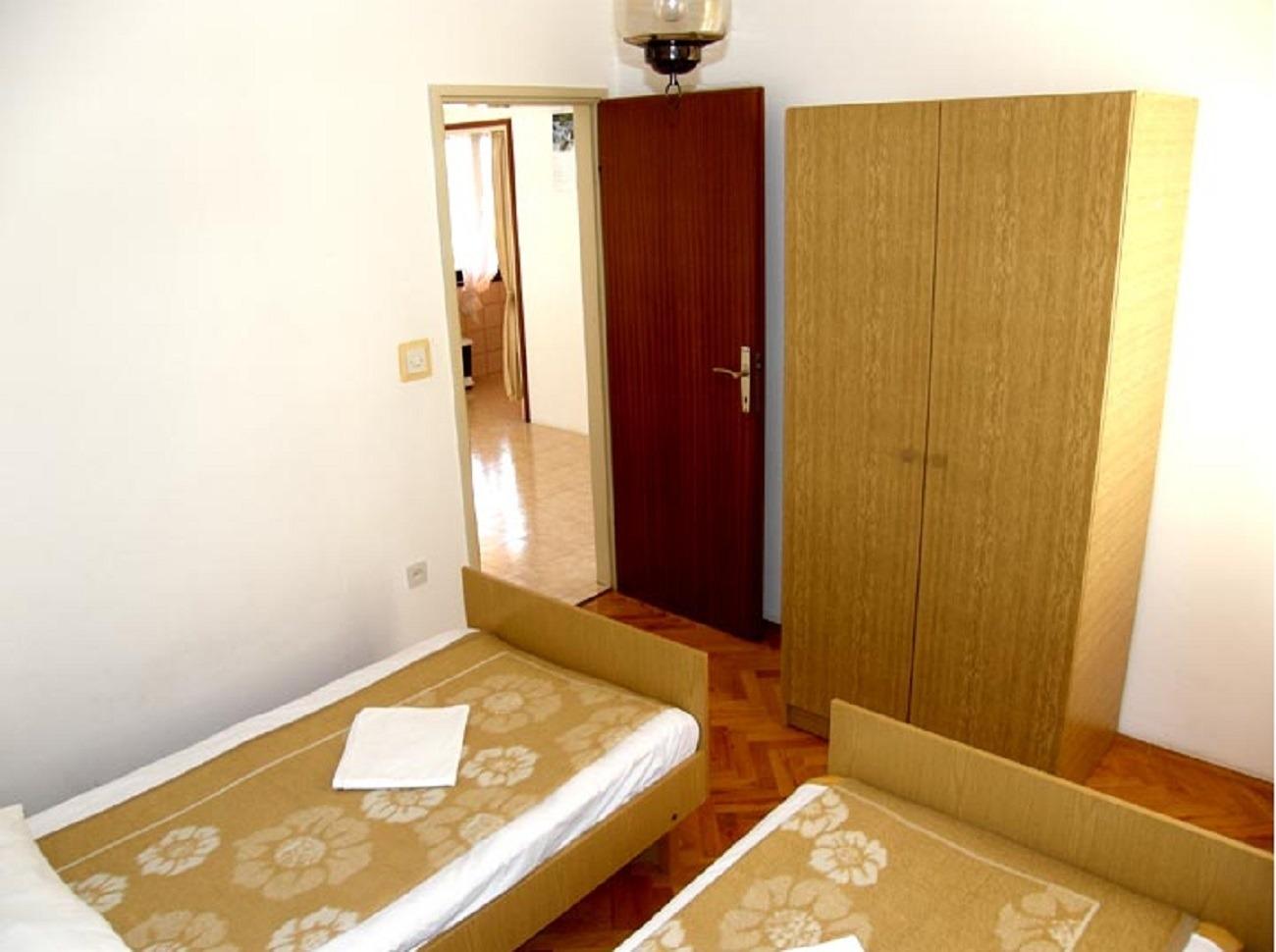 Apartment Apartment Mira - 20 m from pebble beach: A2 Zaboric, Riviera Sibenik 52710, Zaboric, , Region Split-Dalmatia
